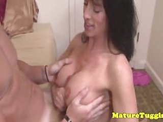 Flashing cougar tugging a young dudes cock