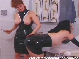 Mature redhead dominatrix shows her new..