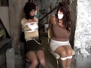 Kellian and Elane tied and gagged by..
