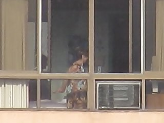 Mature woman naked in the window..