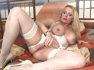 Gorgeous mature mother with huge tits