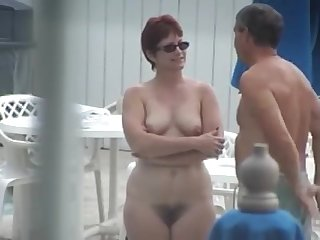 Cute Mature with Full Bush Nude by the..