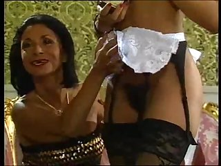 Mature lady and her black maid doing a..