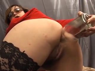 Working the dildo in her ass.