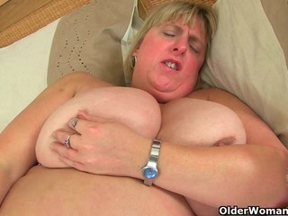 British milf Melons Marie plays with a..