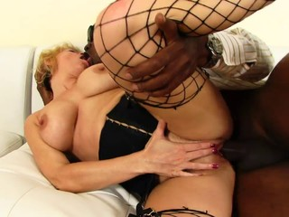 Black hunk has a blonde whore riding his..