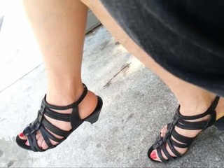 My wife's feet in heels at the tram..