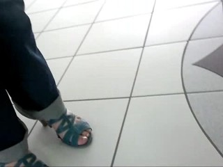 Friend's feet in blue sandals