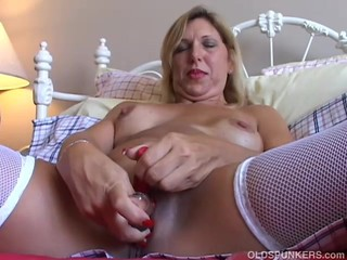 Lovely old spunker in sexy stockings has..