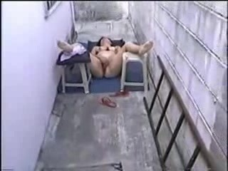 Mature Hispanic masturbates outside again